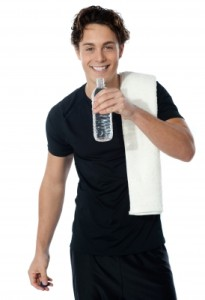 """Fit Man Drinking Water Isolated On White"" by stockimages FreeDigitalPhotos.net"