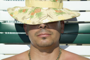 Man Relaxing Under the Sun --- Image by © Royalty-Free/Corbis