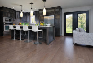 Grey kitchen featuring Greystone color hardwood floor (Maple-Greystone) For more information, visit www.miragefloors.com