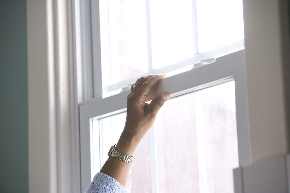 16330-an-african-american-woman-cleaning-a-window-pv