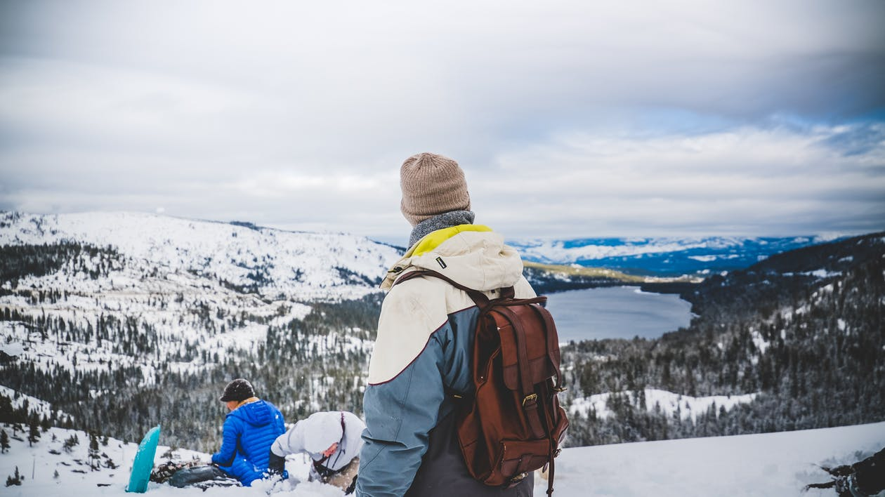 https://www.pexels.com/photo/person-wearing-a-blue-and-white-jacket-and-brown-backpack-standing-on-mountains-62485/