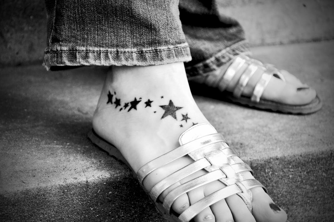 https://www.pexels.com/photo/foot-on-grey-strap-sandals-48805/